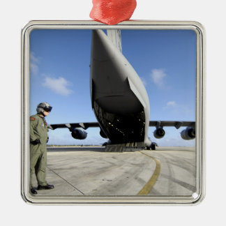 A soldier waits for his C-17 Globemaster III Silver-Colored Square Decoration