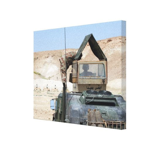 A soldiier instructs an Iraqi army soldier Gallery Wrap Canvas