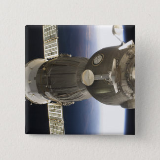 A Soyuz spacecraft backdropped by Earth 15 Cm Square Badge