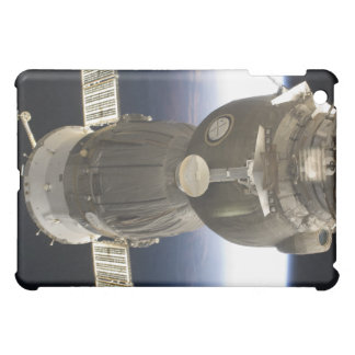 A Soyuz spacecraft backdropped by Earth iPad Mini Cover