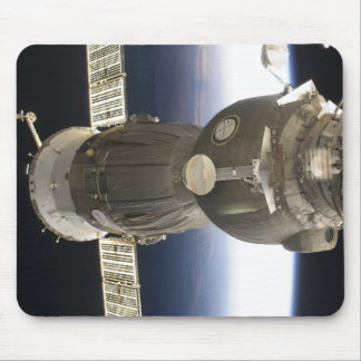 A Soyuz spacecraft backdropped by Earth Mouse Mat