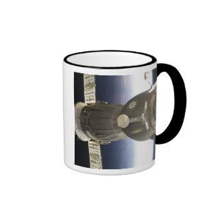 A Soyuz spacecraft backdropped by Earth Ringer Mug