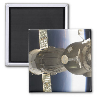 A Soyuz spacecraft backdropped by Earth Square Magnet