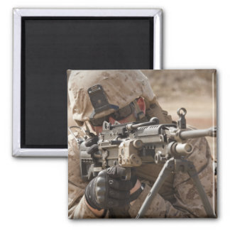 A squad automatic weapon gunner provides securi square magnet