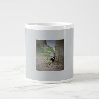 A squirrel on a tree root jumbo mug