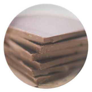A stack of baker's chocolate ready to be chopped party plates