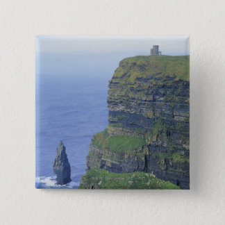 a stone castle standing on top a steep cliff in 15 cm square badge