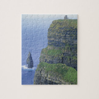 a stone castle standing on top a steep cliff in puzzles