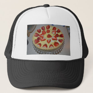 A strawberry cake trucker hat