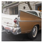 A Studebaker Silver Hawk Classic Car parked on a Large Square Tile