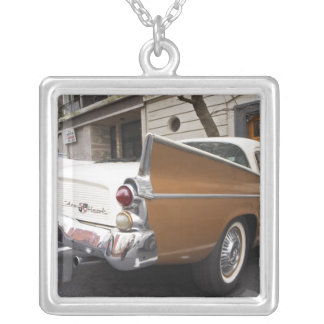 A Studebaker Silver Hawk Classic Car parked on a Silver Plated Necklace