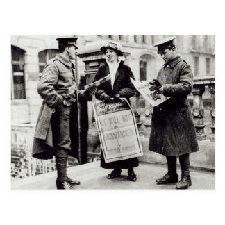 A Suffragette selling newspapers to two Postcard