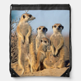 A Suricate family sunning themselves at their den Drawstring Bag