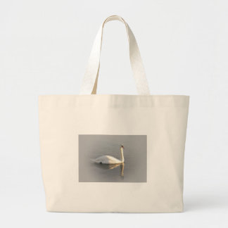A swan gliding by large tote bag