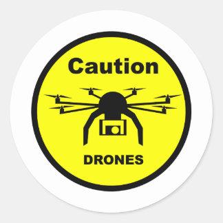 A T-Shirt design featuring a Drone Round Sticker
