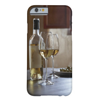 A table with bottle and two glasses of Spanish Barely There iPhone 6 Case