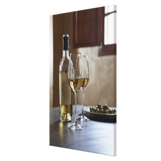 A table with bottle and two glasses of Spanish Canvas Print