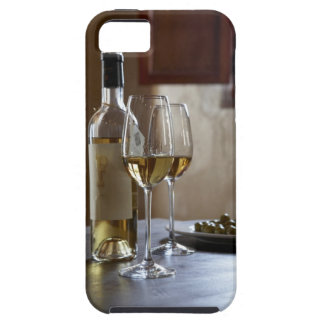 A table with bottle and two glasses of Spanish iPhone 5 Covers