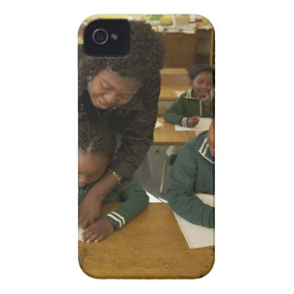 A teacher assists young schoolchildren in her iPhone 4 Case-Mate cases