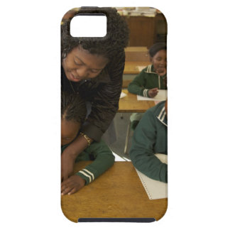 A teacher assists young schoolchildren in her iPhone 5 case