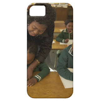 A teacher assists young schoolchildren in her iPhone 5 cover