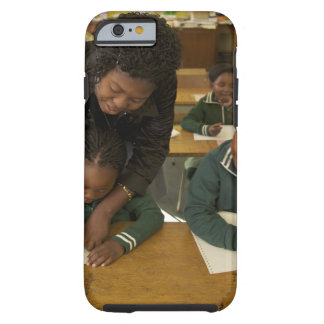 A teacher assists young schoolchildren in her tough iPhone 6 case