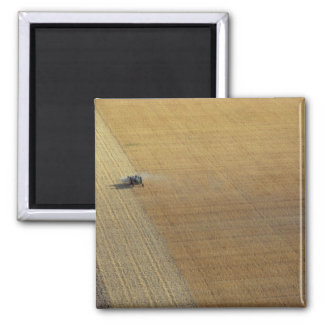A tractor harvesting square magnet