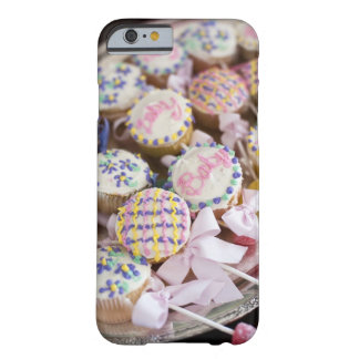 A tray of baby rattle cupcakes at a baby shower. barely there iPhone 6 case