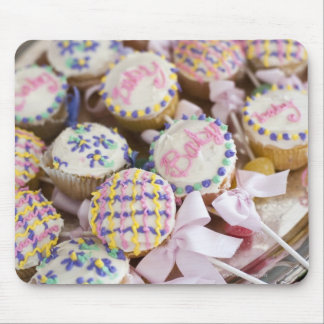 A tray of baby rattle cupcakes at a baby shower. mouse mat