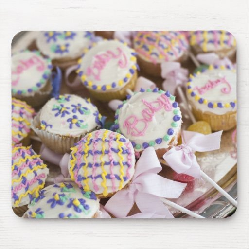 A tray of baby rattle cupcakes at a baby shower. mouse pad