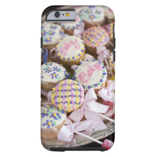 A tray of baby rattle cupcakes at a baby shower. tough iPhone 6 case