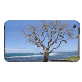 A tree decorated with old buoys on the beach in barely there iPod cover