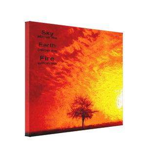 A Tree & Orange, Red & Yellow Sunset Sky Canvas Print