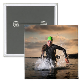 A triathlete at the ocean 15 cm square badge
