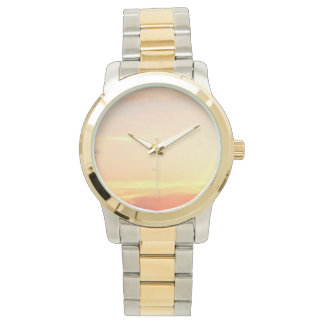 A two-tone gold and silver watch