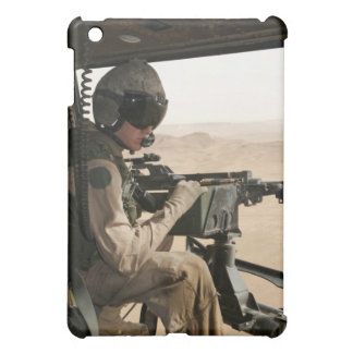 A UH-1N Huey crew chief scans the ground Case For The iPad Mini