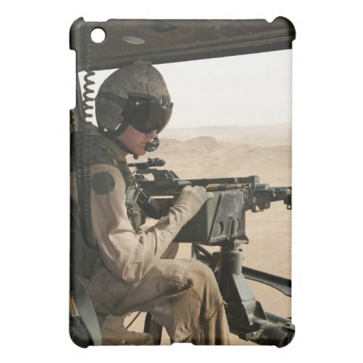 A UH-1N Huey crew chief scans the ground iPad Mini Cases