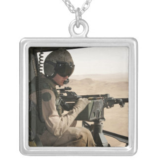 A UH-1N Huey crew chief scans the ground Square Pendant Necklace