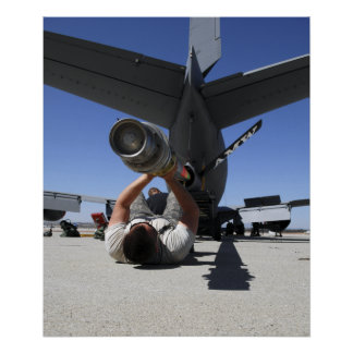 A US Air Force Airman lifts the boom of a KC-13 Poster