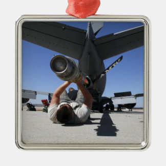 A US Air Force Airman lifts the boom of a KC-13 Silver-Colored Square Decoration