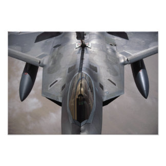 A US Air Force F-22 Raptor is refueled Photo Print