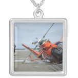 A US Coast Guard MH-65 Dolphin helicopter crash Pendants