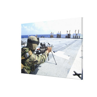 A US Marine adjusting his weapon Canvas Print