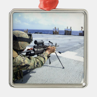 A US Marine adjusting his weapon Christmas Ornament