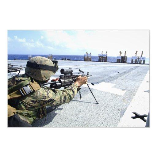 A US Marine adjusting his weapon Art Photo