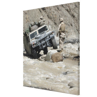 A US Marine guiding the driver of a Humvee Gallery Wrapped Canvas