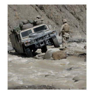 A US Marine guiding the driver of a Humvee Poster