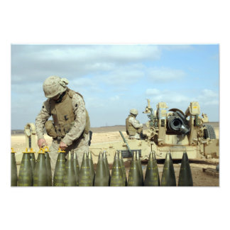 A US Marine prepares howitzer rounds to be fire Art Photo