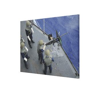 A US Sailor fires a 50-caliber M2HB Canvas Print