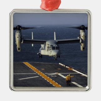 A V-22 Osprey aircraft prepares to land Christmas Ornament
